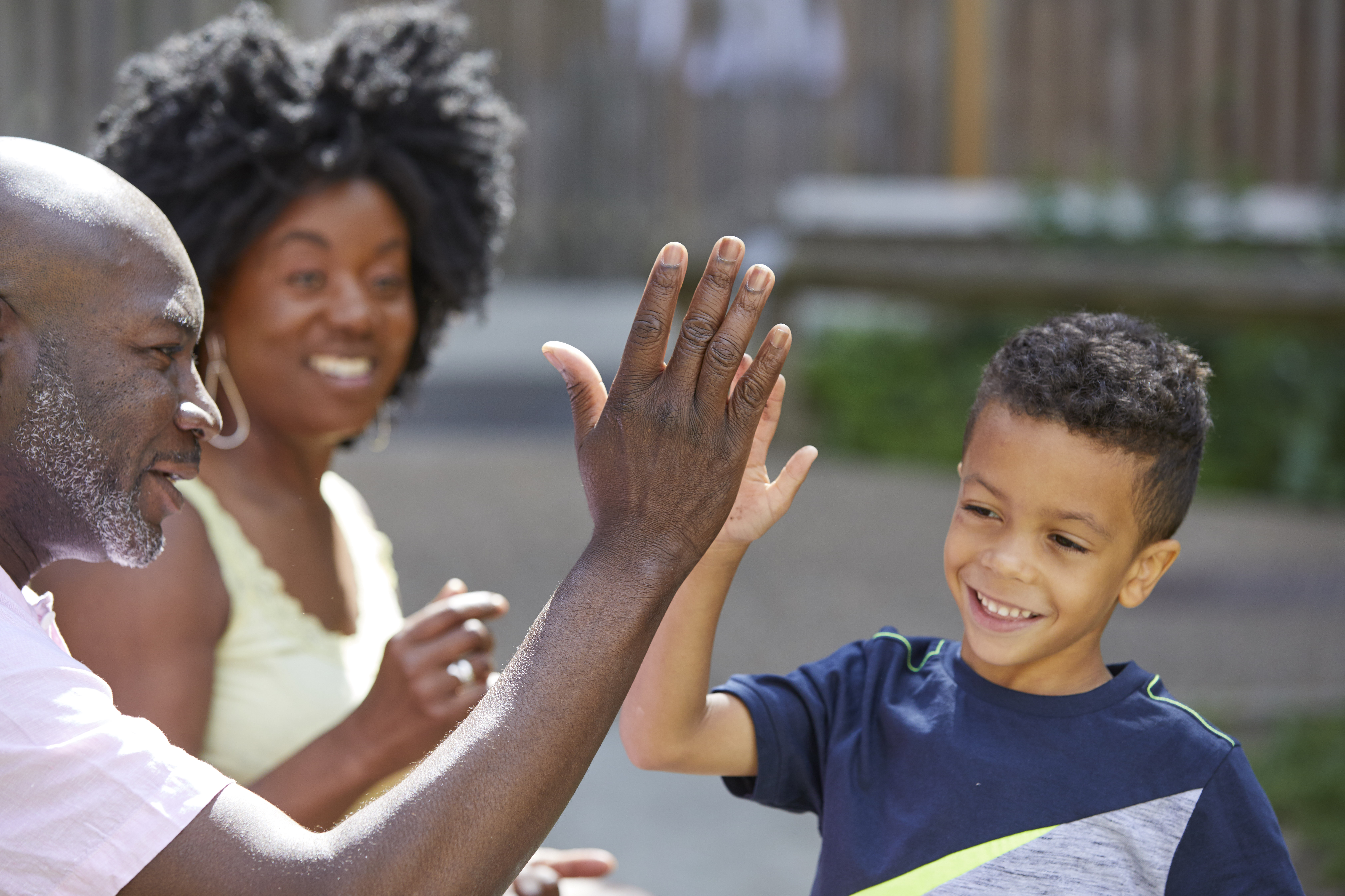Child high five with adult