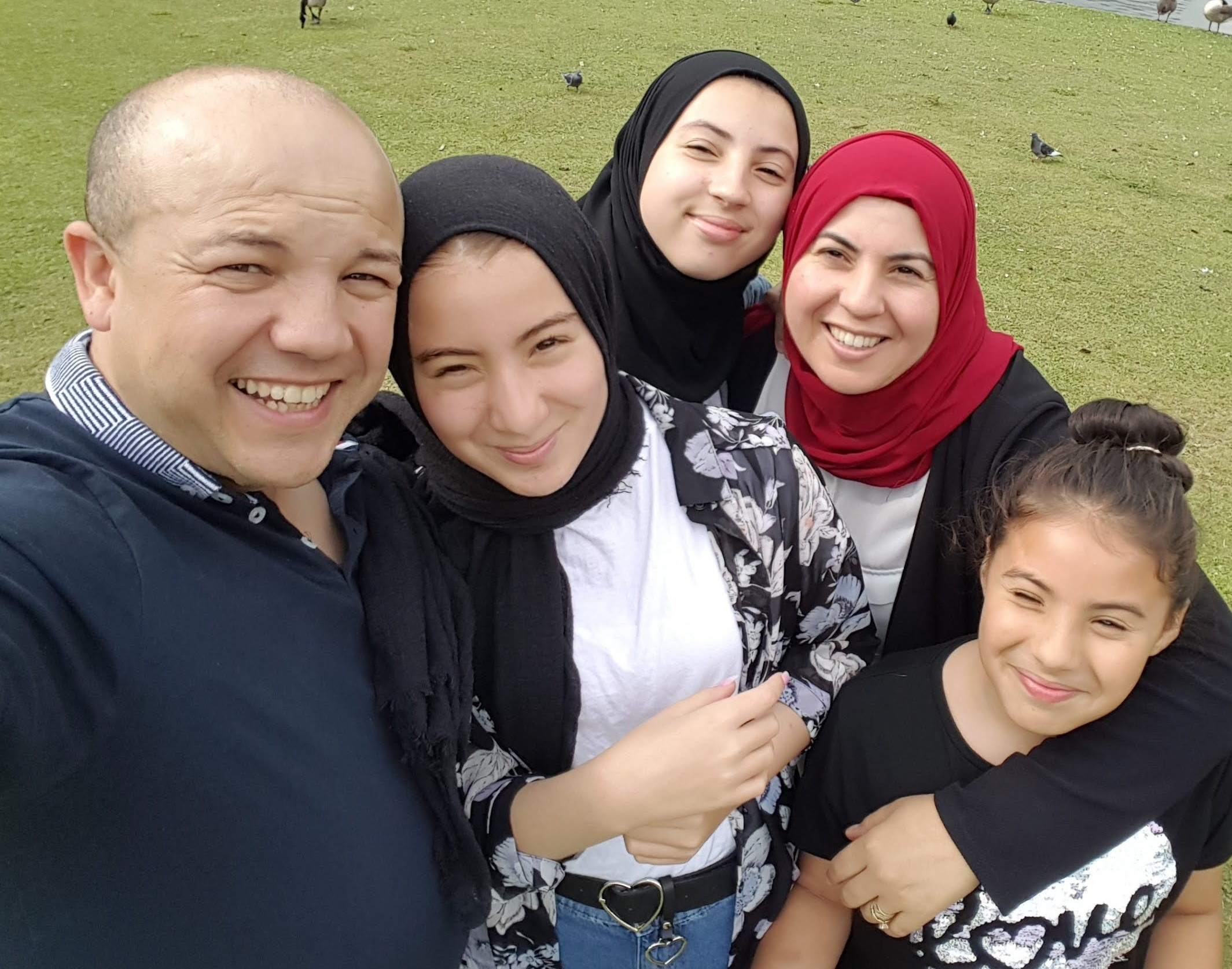 Foster Carers Djahida and Sofiane with their daughters